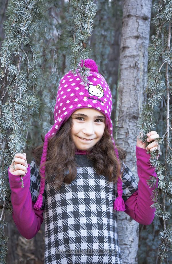 Fotografía del reportaje book niño, con gorra
