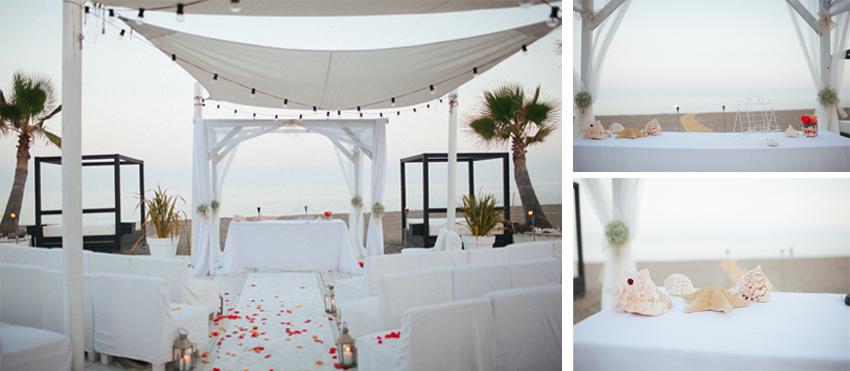 fotografia de boda en la playa altar decorado con conchas y pétalos de resas